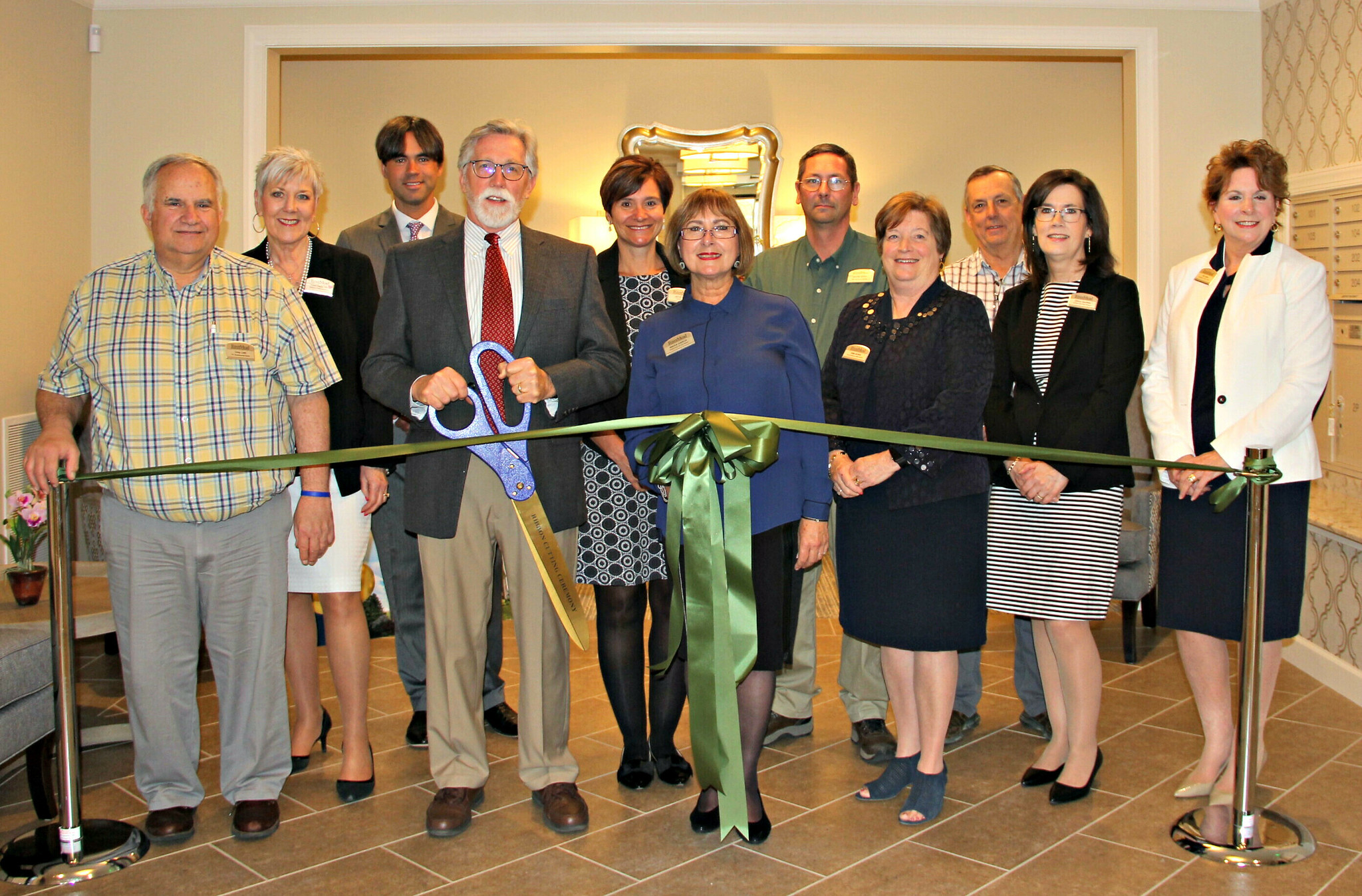 Managers Ribbon Cutting Villas